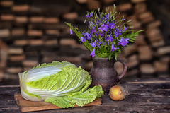 Still life with lettuce leaves on a table Stock Photography