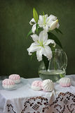 Still life with lilies. On a green background Royalty Free Stock Image