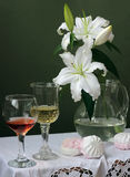 Still life with lilies. On a green background Stock Photography