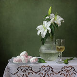 Still life with lilies. On a green background Stock Images