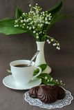 Still-life with lily of the valley, a book and a cup of coffee Stock Photos