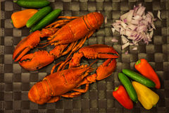 Still life with lobster mini peppers and cucumbers Stock Images