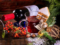 Still life of lying on table wine bottle and mug . Royalty Free Stock Image