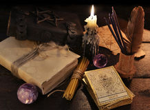 Still life with magic objects and the tarot cards. Still life with magic objects, books, candles and the tarot cards. Halloween and magic still life, fortune royalty free stock images
