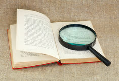 Still life of magnifying glass and old book Royalty Free Stock Images