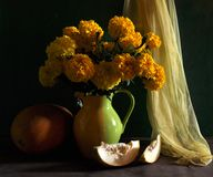 Still life with marigolds and melon Royalty Free Stock Images