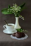 Still life with marshmallows, a cup of coffee and a sprig of lily of the valley Royalty Free Stock Photography
