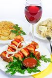 Still life with meat, dumplings and wine. Royalty Free Stock Images