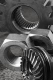 Still-life of mechanical parts. Cog, gears and nuts in black/white Stock Photography