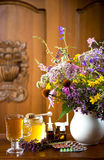 Still life from medicinal herbs, honey, herbal tea and medicines Royalty Free Stock Photography