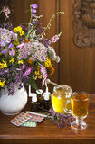 Still life from medicinal herbs, honey, herbal tea and medicines Royalty Free Stock Images