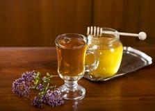 Still life from medicinal herbs, honey, herbal tea Stock Photos