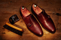 Still life with men`s leather shoes and accessories for shoes ca Royalty Free Stock Images