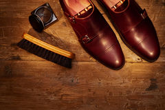 Still life with men`s leather shoes and accessories for shoes ca Royalty Free Stock Image
