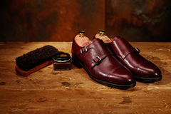 Still life with men`s leather shoes and accessories for shoes ca Stock Photo