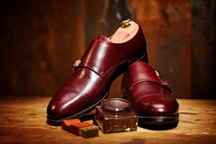 Still life with men`s leather shoes and accessories for shoes ca Stock Photography