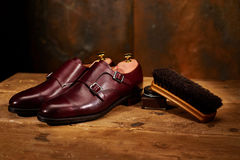 Still life with men`s leather shoes and accessories for shoes ca Royalty Free Stock Photos