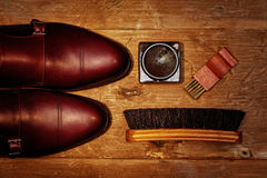 Still life with men`s leather shoes and accessories for shoes care. Royalty Free Stock Image