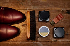 Still life with men`s leather shoes and accessories for shoes care. Royalty Free Stock Photos
