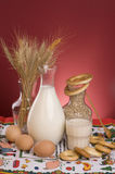 Still life with milk, cereals, grains and eggs. Domestic still life with bottle of milk,wheat cereals,bagels, grains, spoon, glass and eggs Royalty Free Stock Photography