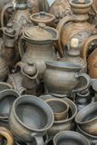 Still life with modern pottery vessels made of clay. Burnt black ceramics. Burned clay jars. vertical photo.  stock image