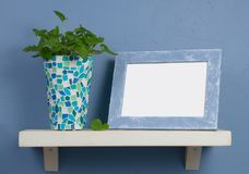Still-life with mosaic vase and frame Stock Images
