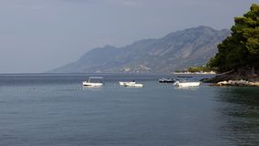 Still life with motor boats for rent at sea stock photos