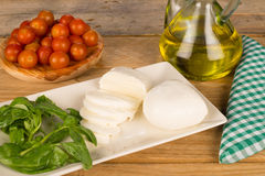 Cooking with mozzarella and pomodorini Royalty Free Stock Images