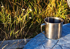 Still life with mug and wildflowers. In the summer in the village Stock Photography