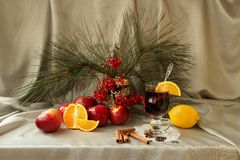 Still life with mulled wine, apple, orange and spices Stock Photo