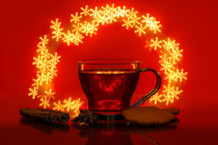 Still life with mulled wine, cinnamon, star anise and bokeh like snowflakes. Still life with mulled wine, cinnamon, star anise, gingerbread and bokeh like stock images