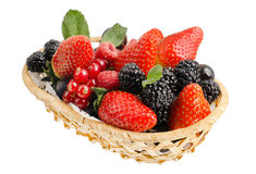 Still life multifruit. Still life of  heap multi-coloured  berrys in  basket, on white background, isolated Stock Photos