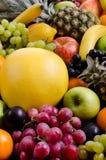 Still life multifruit background. Still life of big  heap multi-coloured fruits, vertical  background Stock Photos