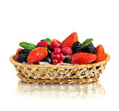 Still life multifruit. Still life of  heap multi-coloured  berrys in  basket, on white background, isolated Stock Image