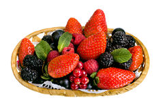 Still life multifruit. Still life of  heap multi-coloured  berrys in  basket, on white background, isolated Stock Photo