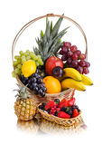 Still life multifruit. Still life of  multi-coloured fruits in big  basket, on white background, isolated Stock Photography