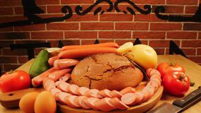 Still life with natural sausages rye bread and vegetables