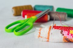 Still-life of needlework: cloth, scissors, thread, needle_ Royalty Free Stock Photography