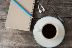 Still life with notebook , pencil, Earphone , glasses Royalty Free Stock Images