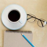 Still life with notebook , pencil,  glasses and cup of coffee Royalty Free Stock Photo