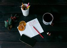 Still-life with a notebook with a red inscription 2018, a Cup of coffee stock photos