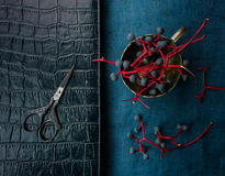 Still life. notebook, scissors, and bunches of wild grapes. close-up. top view Royalty Free Stock Photos