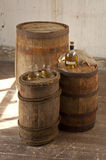 Still Life with oak barrels and whiskey. Still life with three barrels of two glasses and a bottle of whiskey Royalty Free Stock Photos