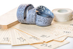 Still Life Of Perforated Punched Tapes And Card With Old Data Is Stock Photography