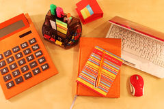 Still Life of office desktop in orange color Royalty Free Stock Photography