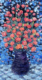 Still life oil. Bouquet of red flowers on blue background Royalty Free Stock Images