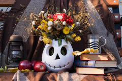 Still life an oil lamp, apples, a vase with the flowers. Photo a still life an oil lamp, apples, a vase with the flowers in the form of Jack and the book against Royalty Free Stock Photo