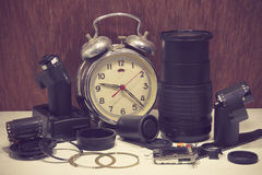 Still life with old broken alarm clock, broken camera lens, came Royalty Free Stock Image