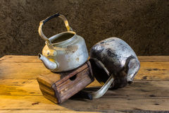 Still life old classic kettle with Old chest Royalty Free Stock Image
