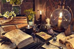 Still life with old-fashioned lamp, magic witch books, tarot cards and old papers. Mystic background with ritual esoteric objects, occult, fortune telling and royalty free stock image